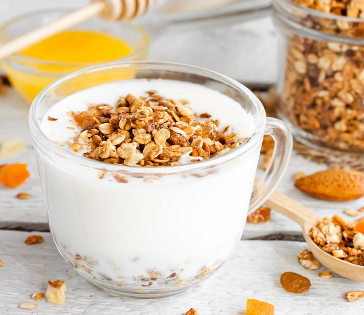 yogurt with homemade granola, nuts and dried fruits in a glass c